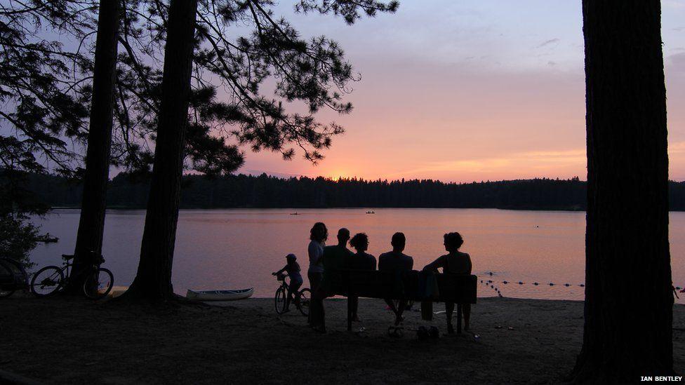 Friends enjoying the sunset over Pog Lake