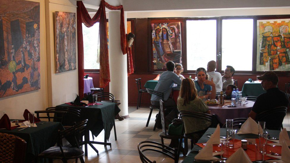 Customers at tables in the Makush Art Gallery & Restaurant in Addis Ababa, Ethiopia