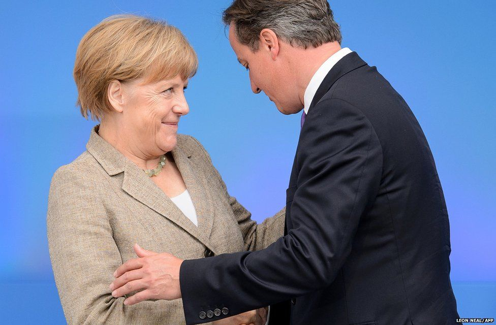 British Prime Minister David Cameron greets German Chancellor Angela Merkel during the 2014 Nato Summit in Newport, Wales