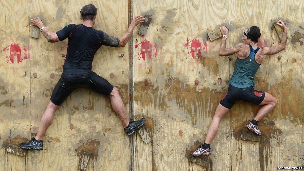 Competitors take part in the Spartan Sprint event at Pippingford Park in East Sussex.