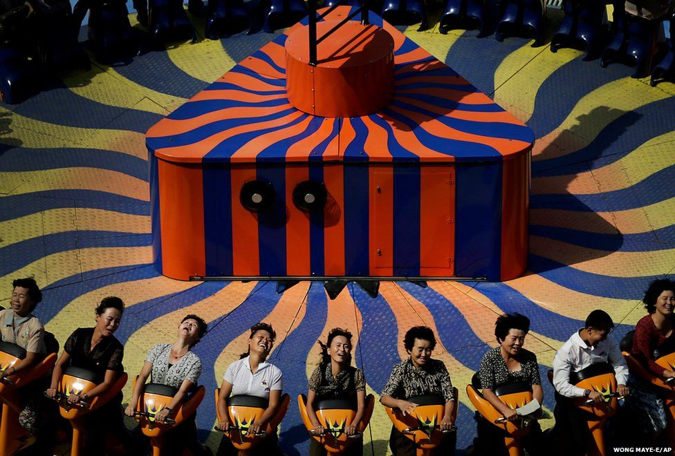 North Koreans enjoy a ride at the Kaeson Youth Amusement Park