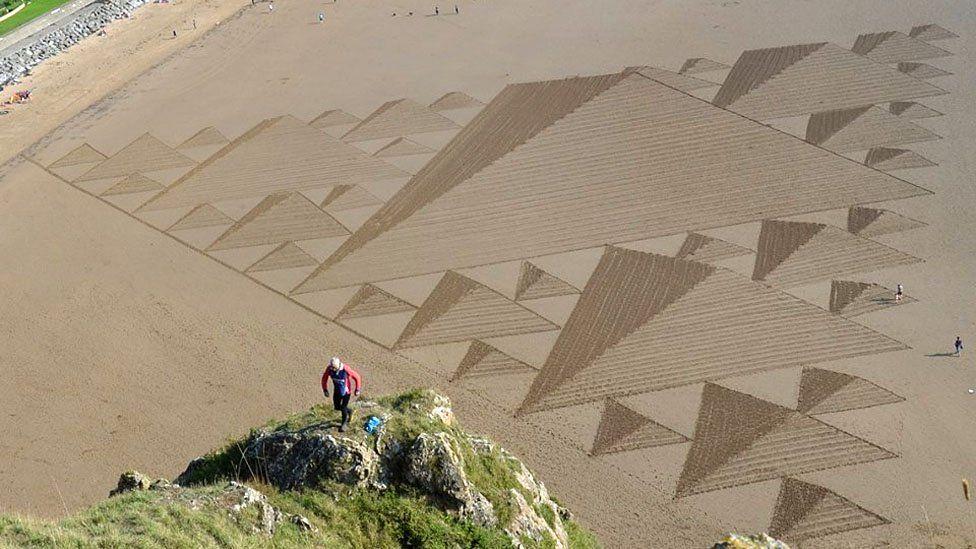 Sand art by Simon Beck at Brean Beach, Somerset