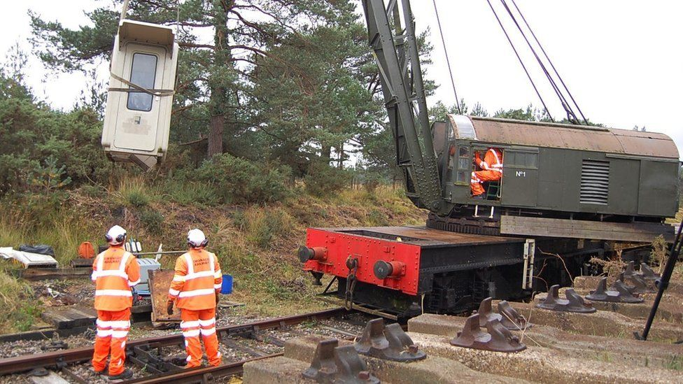 Signalling hut being removed