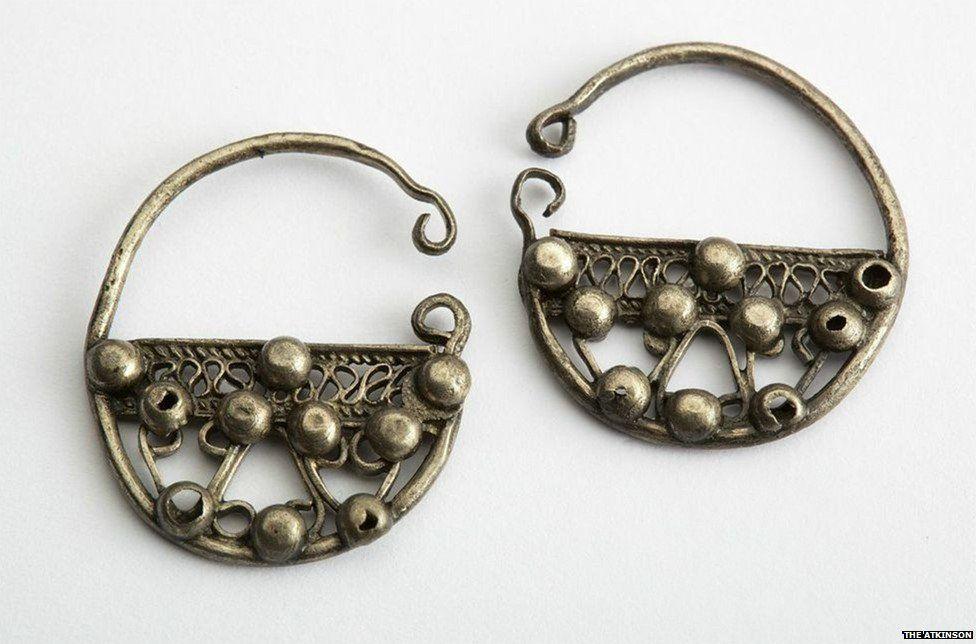 Pair of silver penannular earrings