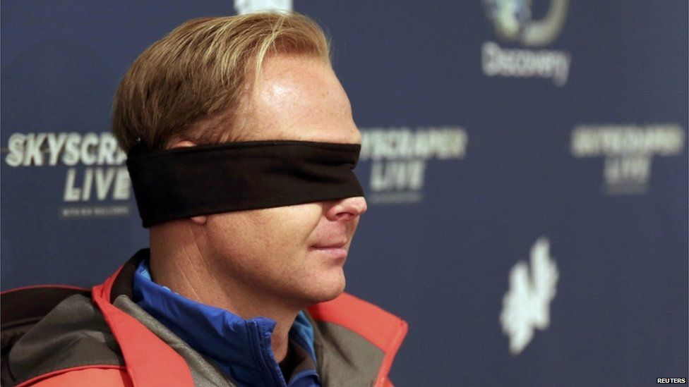 Nik Wallenda wears his blindfold while answering questions about his blindfolded walk