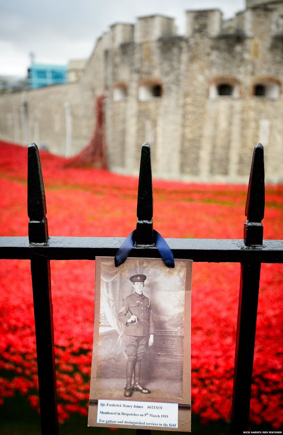 Photograph of soldier on the railings
