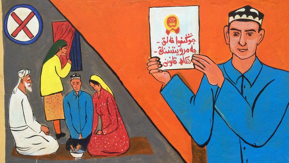 A mural is painted on the walls next to a mosque in the old Silk Road district of Kashgar