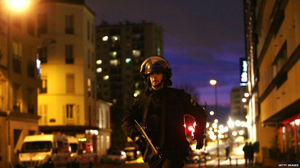 Police in streets near supermarket