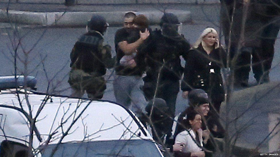 Hostages fleeing supermarket