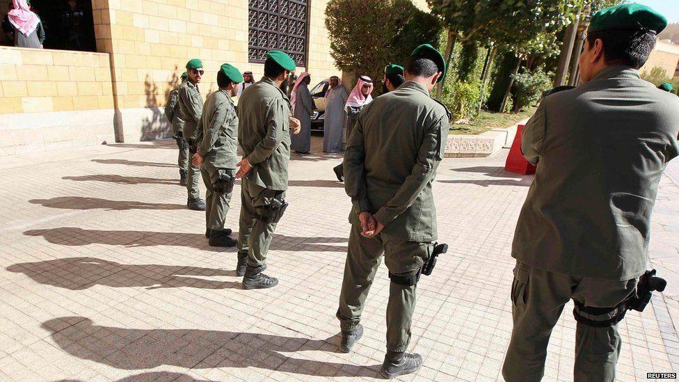Members of Saudi security forces stand guard during the funeral of Saudi King Abdullah bin Abdulaziz in Riyadh on 23 January 2015