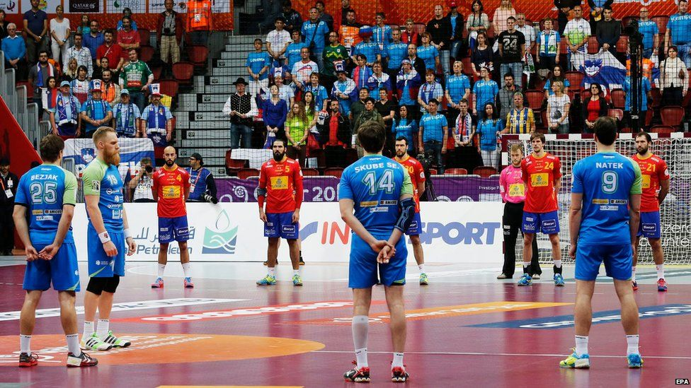 Players and spectators observe a minute of silence for King Abdullah of Saudi Arabia before the Qatar 2015 24th Men's Handball World Championship match between Spain and Slovenia at the Duhail Handball Sports Hall in Doha, Qatar, on 23 January 2015
