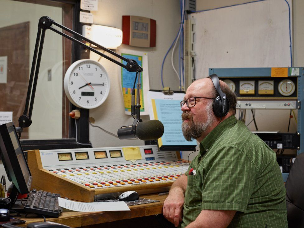 Chuck Niday in a radio studio