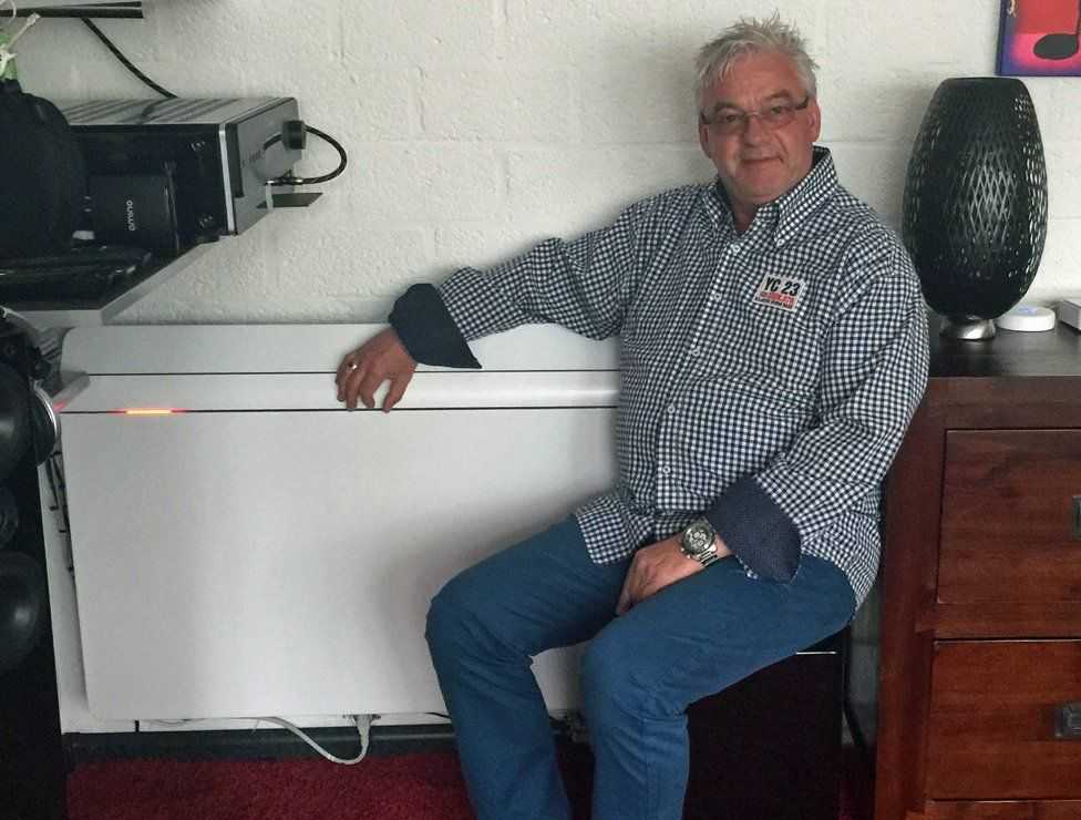Jerry van Waardhuizen sitting next to his radiator