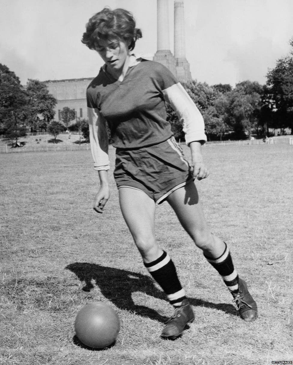 Joan Briggs, England centre forward, training at Battersea Park, London, in July 1959
