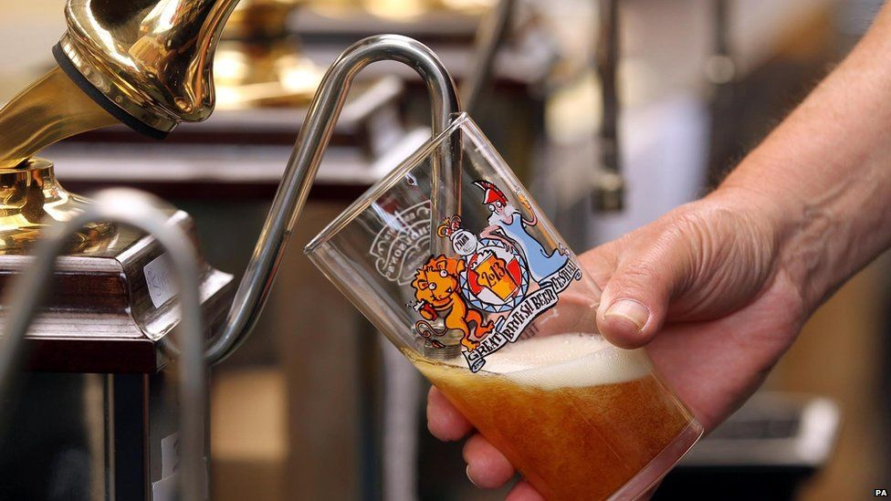 Someone pouring a pint