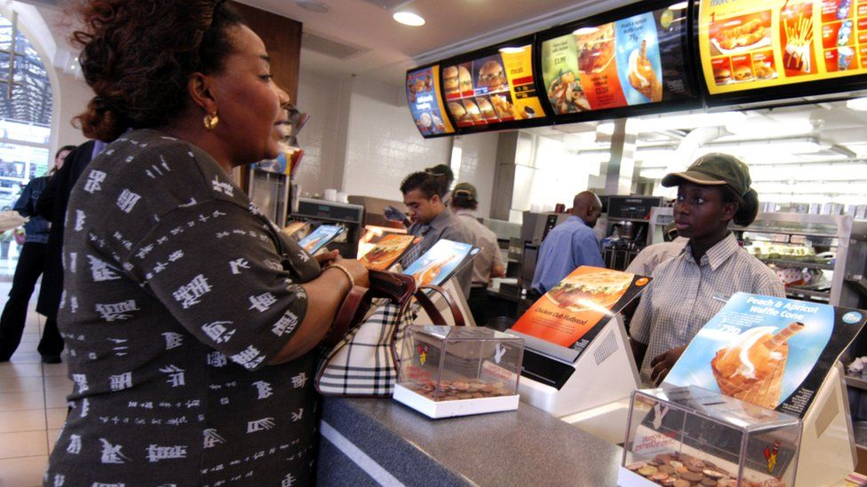 Women being served in a fast food restaurant