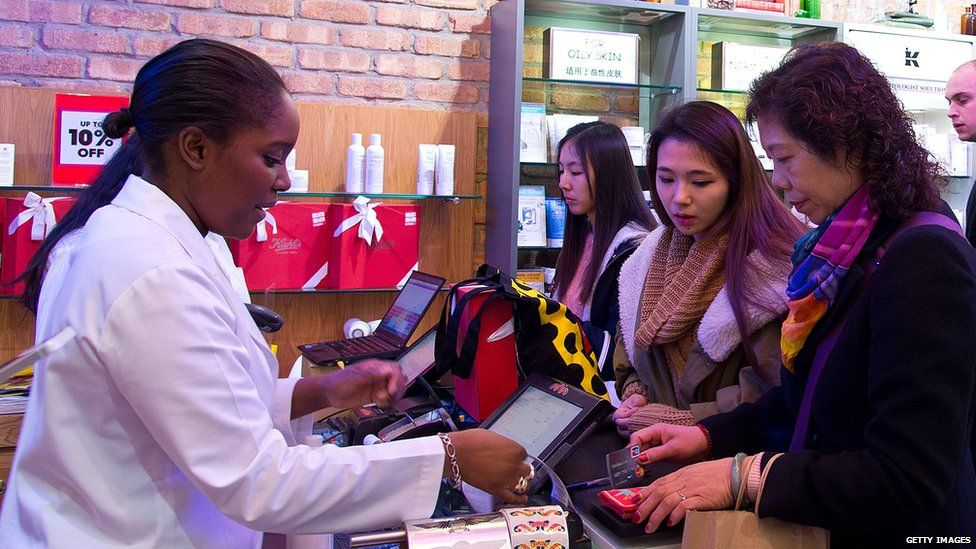 Women being served in a shop