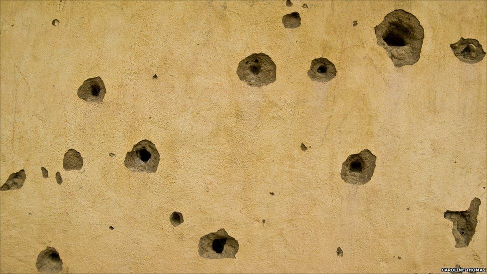 Bullet holes in the mosque in the village of Potoru