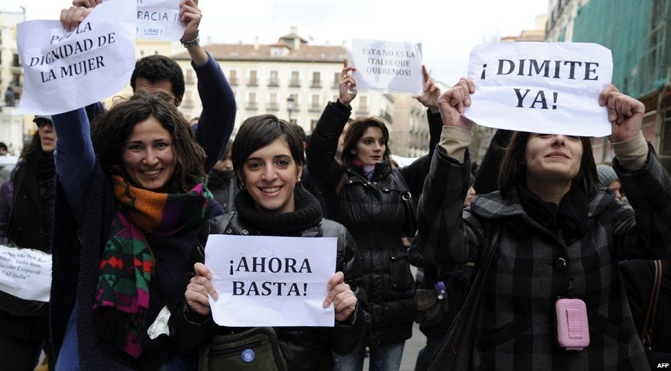 Protesters in Madrid hold signs saying 'enough' and supporting the dignity of women, Spain (13 Feb 2011)
