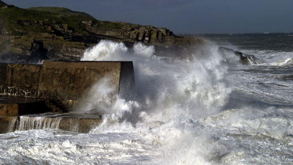 Waves crashing on Collieston Pier