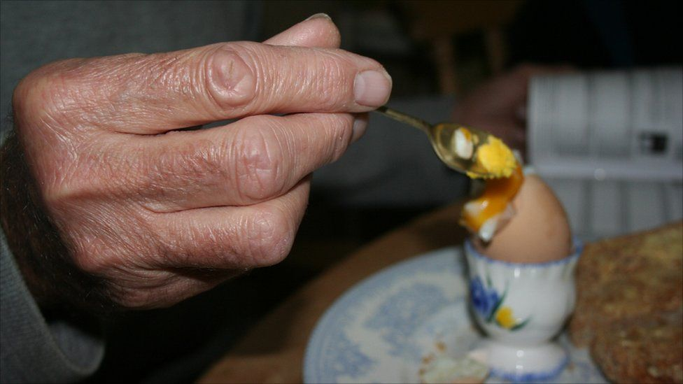 A man eating a boiled egg
