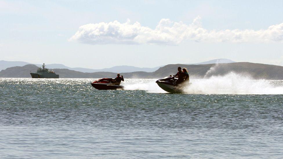 People on jet skis off Braighe on the Isle of Lewis