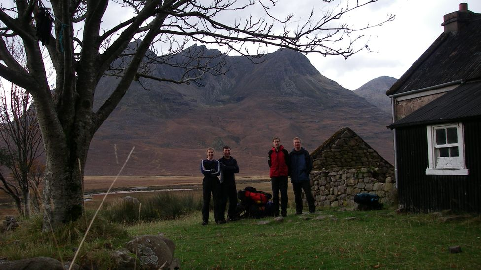 People standing outside a bothy