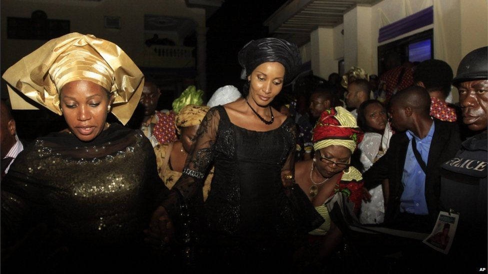 Bianca Ojukwu, centre, widow of Chukwuemeka Ojukwu