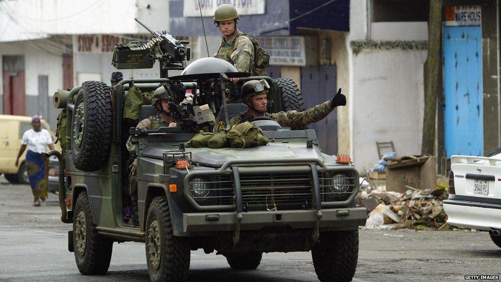 US Marines patrol the streets of Monrovia, 24 August 2003