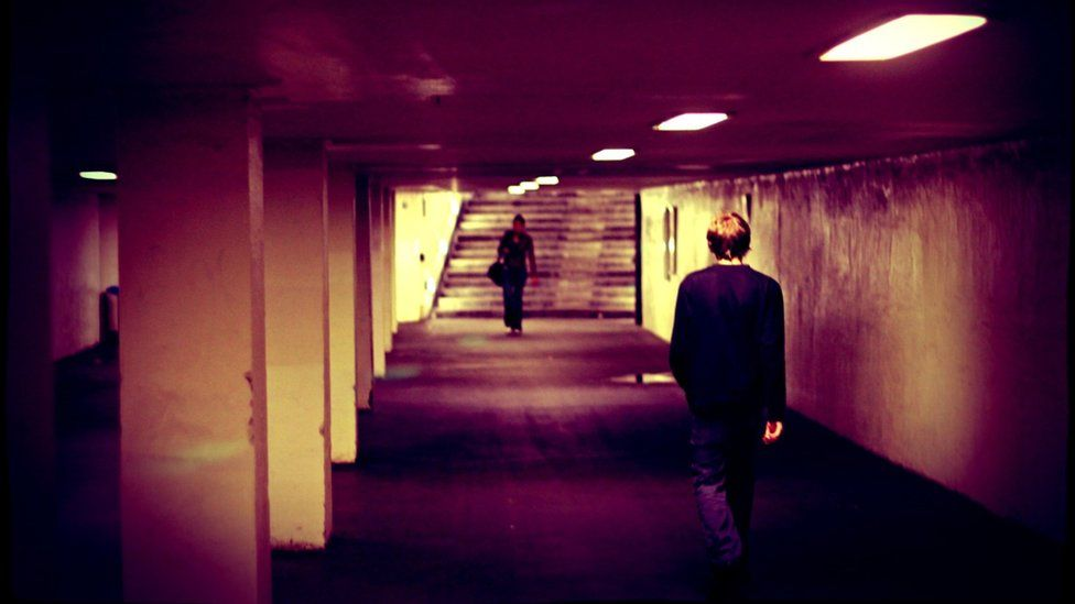 People walking through an underpass