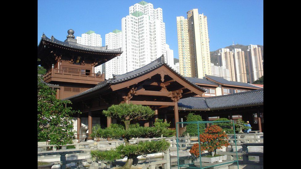 The Chi Lin Nunnery with the Hong Kong skyline in the background