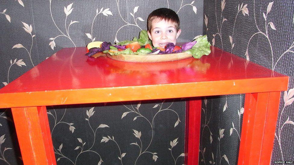 A boy's head on a plate
