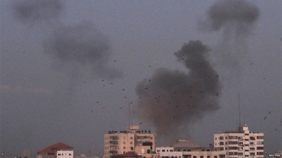A plume of smoke rises above Gaza City (14 November).