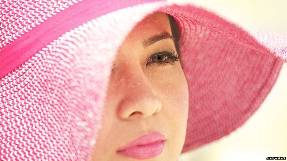 Woman in pink hat