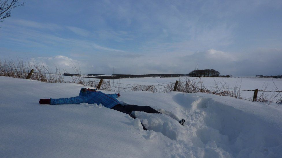 Laura makes a snow angel