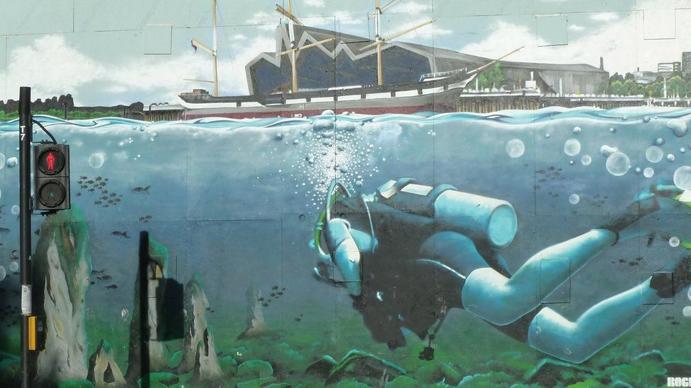 Painting of a scuba diver and the Riverside Museum by a pedestrian crossing