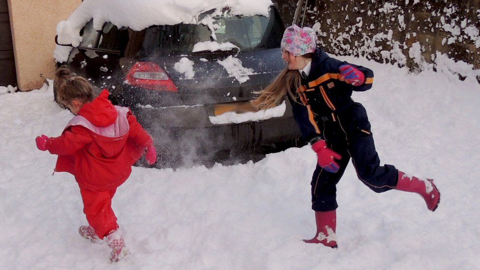 Emily and Becca playing in the snow