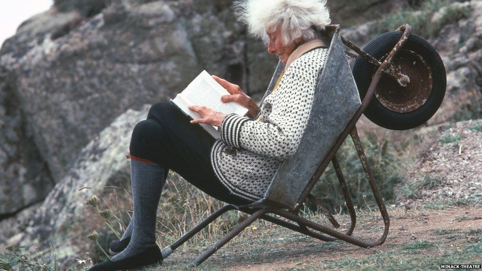 Rowena Cade relaxes in a wheelbarrow at the Minack Theatre