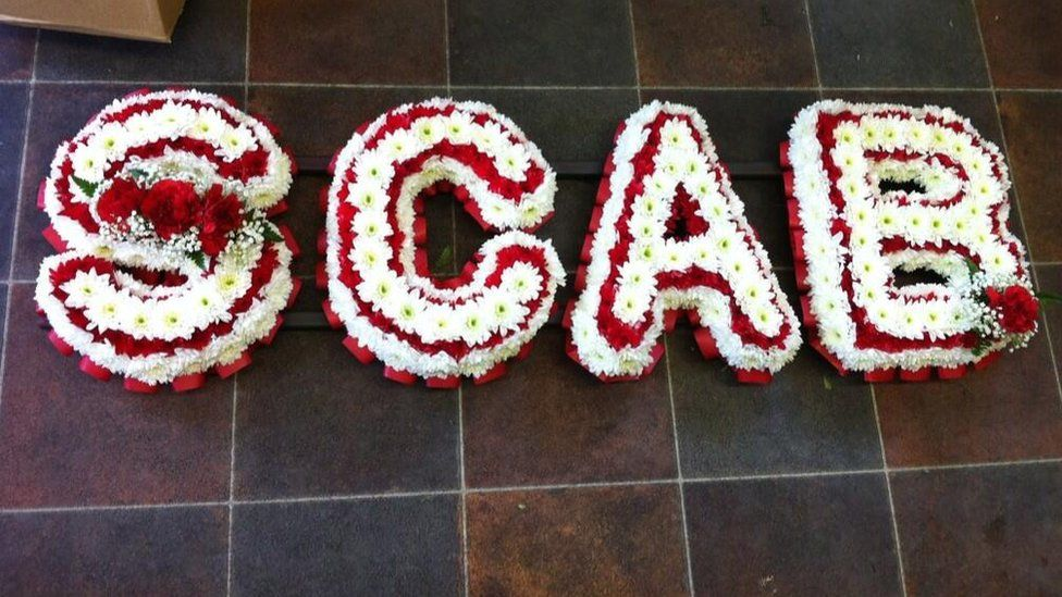 Floral 'tribute' to Margaret Thatcher referring to the Miners' Strike
