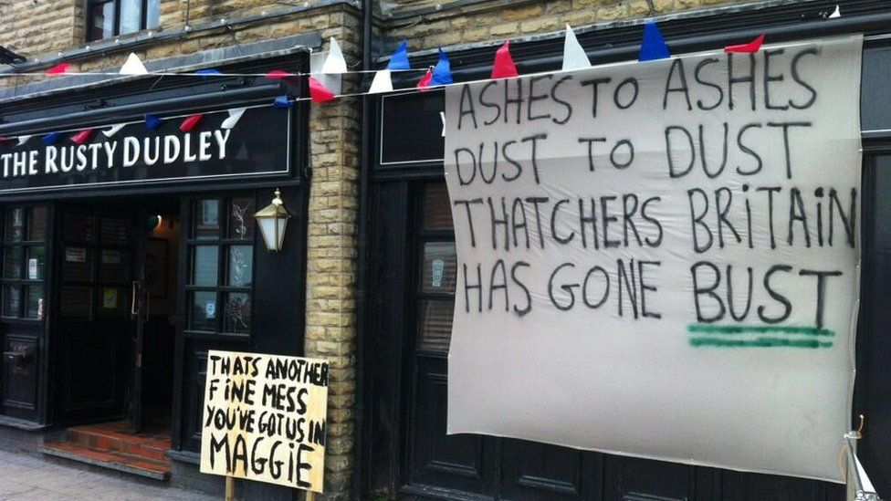 Anti-Margaret Thatcher messages written on a placard and a sheet