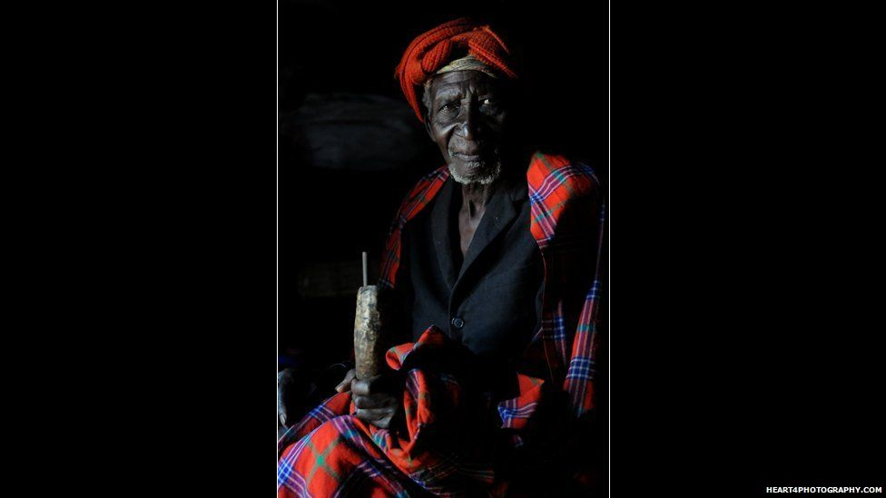 A traditional healer in southern Tanzania holding a horn containing medicine