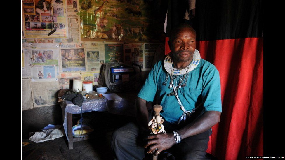 Traditional healer in southern Tanzania holding an ancestral stick