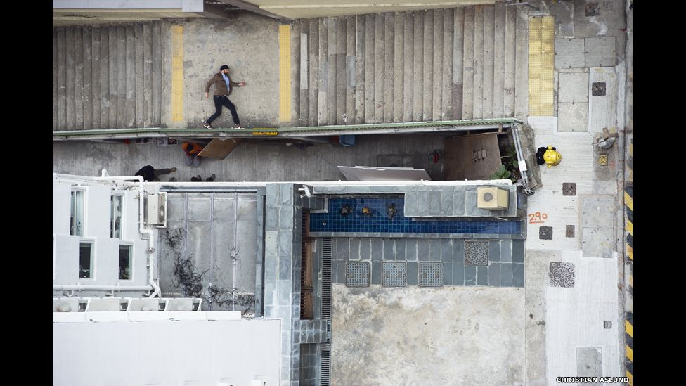 Man lying on the street as seen from above