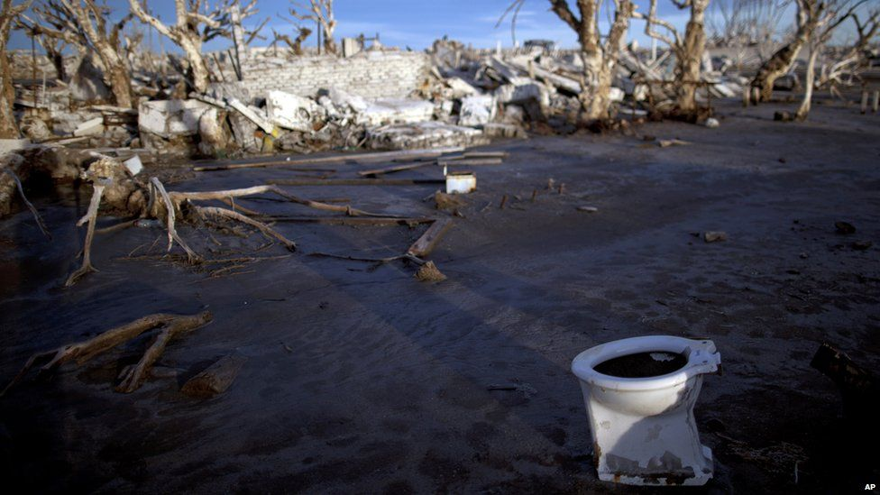 Toilet lies in the ruins of Epecuen, Argentina, on 7 May 2013