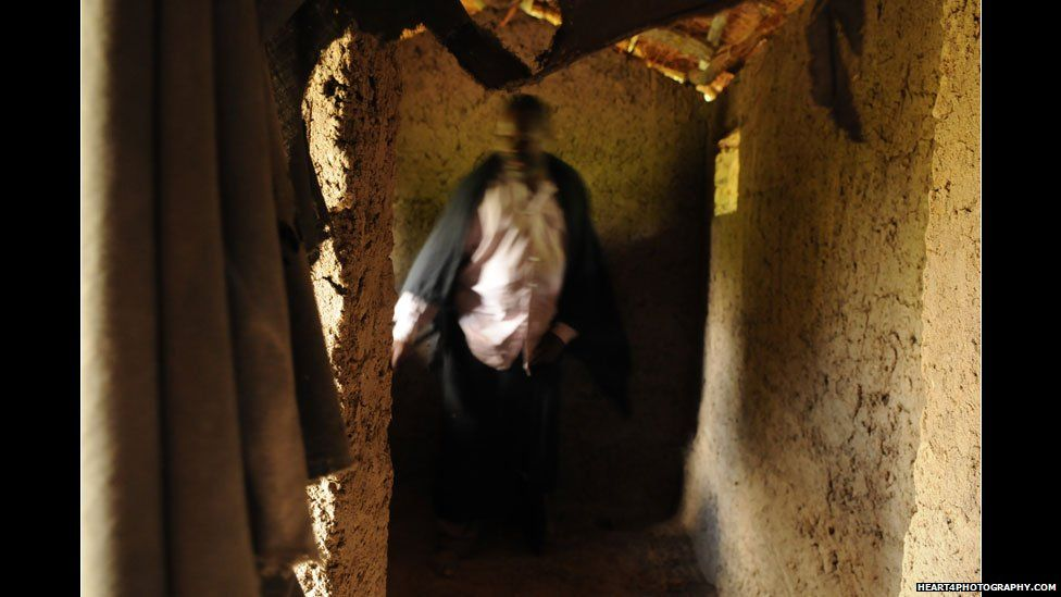 Traditional healer in southern Tanzania in his house