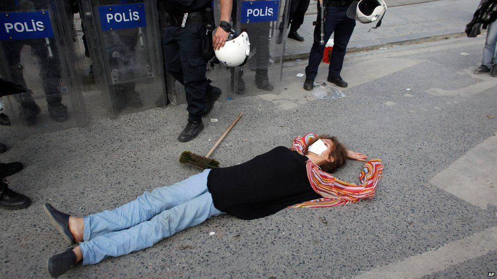 Protester lies in front of police in Taksim Square, Istanbul, Turkey, on 11 June 2013