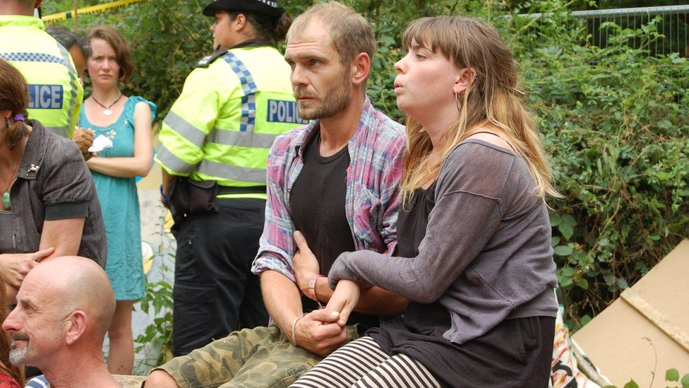 Man and woman waiting to be arrested