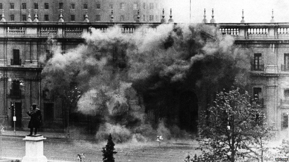 The Chilean presidential palace La Moneda under fire during the coup
