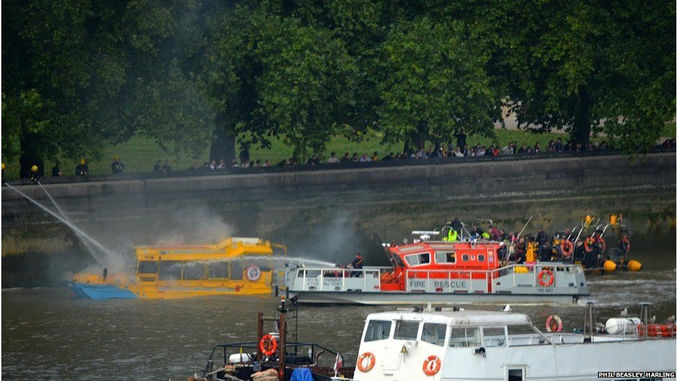 Firefighters spray water cannons at the 'duck boat'. Photo: Phil Beasley-Harling
