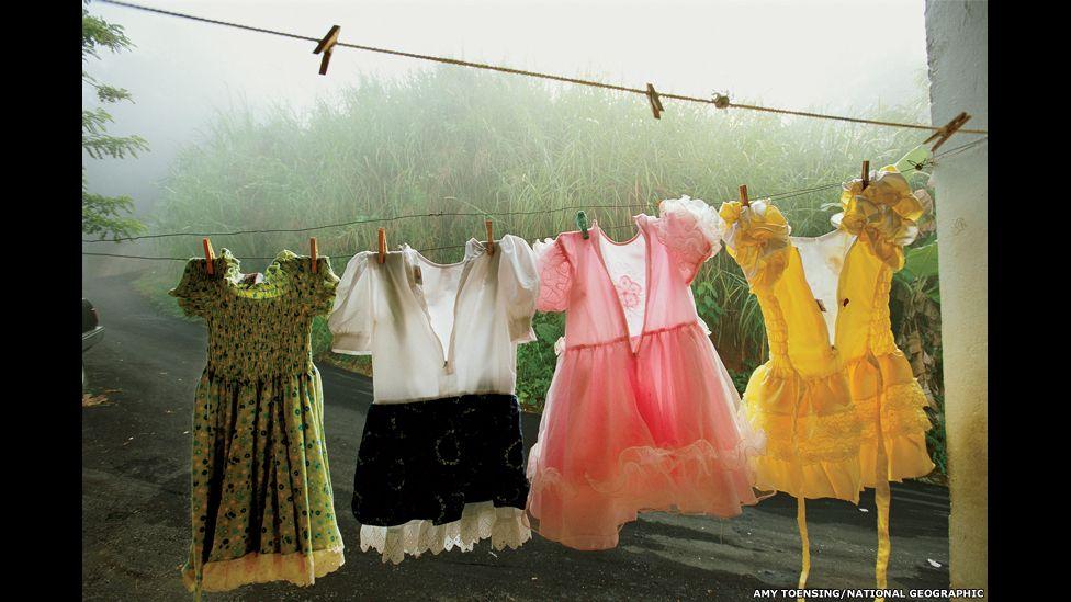 Dresses festoon a clothesline in Utuado, a lush mountainous region in central Puerto Rico.